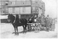 Black and White Photo of Firefighers by Horse Drawn Wagon