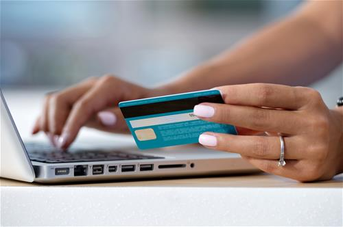 Online Payments - Woman Entering Credit Card Information into Laptop